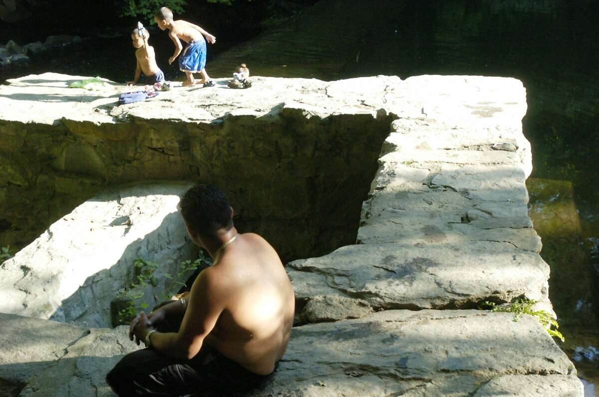 Stamford_090104_Riverbank Park, Newman Mills, whatever you call it, is a favorite swimming hole and hang-out spot despite No Swimming signs and occasional locked gates. Andrew Sullivan/Staff photo