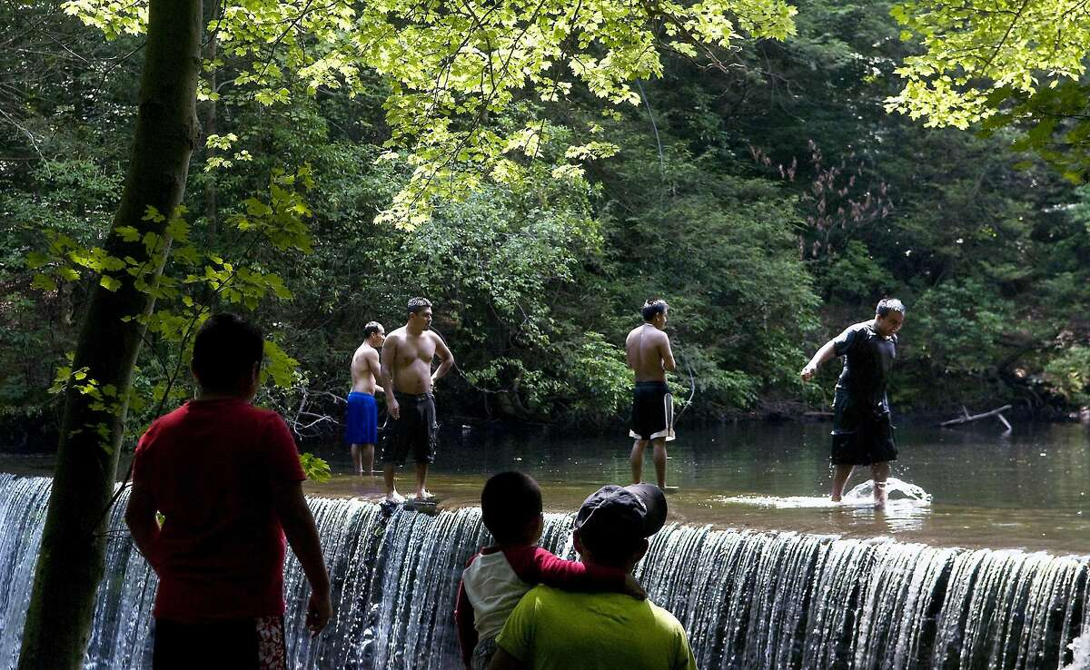 Stamford_072809_ Swimmers enjoy an afternoon by the waterfall at Newman Mills Park, which is off of Riverbank Road just north of the Merritt Parkway. Kathleen O'Rourke/Staff photo