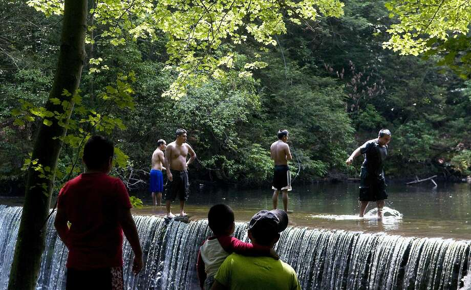 Swimmers enjoy an afternoon by the waterfall at Newman Mills Park. Photo: Kathleen O'Rourke, ST