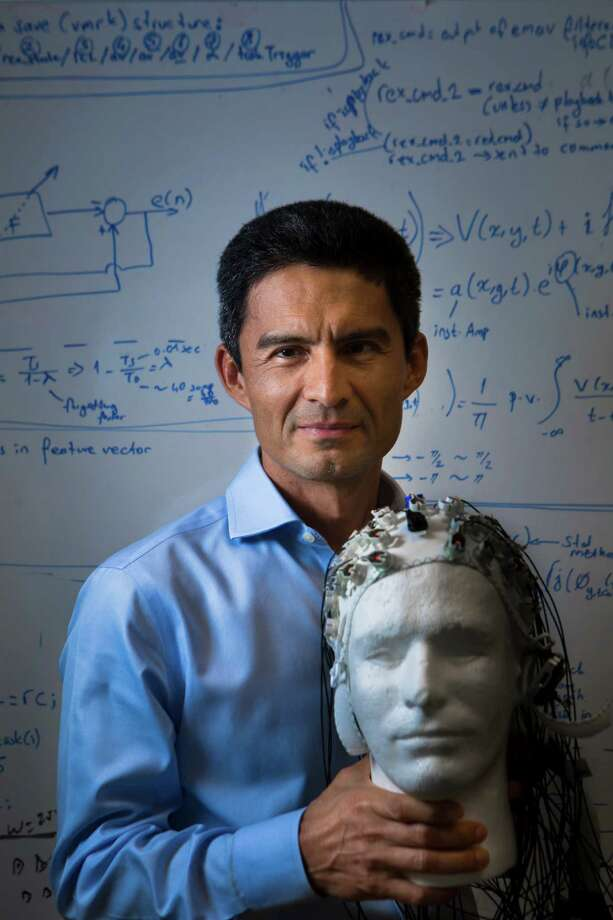 University of Houston professor Jose Luis Contreras-Vidal is testing babies and toddlers to track brainwaves with an electroencephalography sensor cap. Photo: Marie D. De Jesus, Staff / © 2014 Houston Chronicle