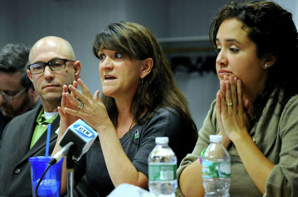 From left, Jeremy Richman and Jennifer Hensel, parents of shooting victim Avielle Richman, and Nelba Marquez-Greene, mother of victim Ana Marquez-Greene, testify before the Sandy Hook Advisory Commission, Friday, Nov. 14, 2014, at the C.H. Booth Library in Newtown, Conn.