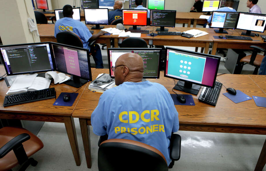Inmate Larry Histon works a computer coding assignment as San Quentin State Prison inmates take advantage of a new class. Photo: Michael Macor / ONLINE_YES