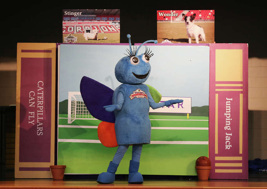 "Morgan's Wonderland mascot, Joy the Butterfly, played by Allie Boyles, present the dogs used as the basis for the play, ""The Adventures of Wonder and Stinger.""  The play features Stinger, a dog with no front paws, and his playmate, Wonder, and it delivers an anti-bullying message. Photo: JERRY LARA / Jerry Lara / San Antonio Express-News / © 2014 San Antonio Express-News"
