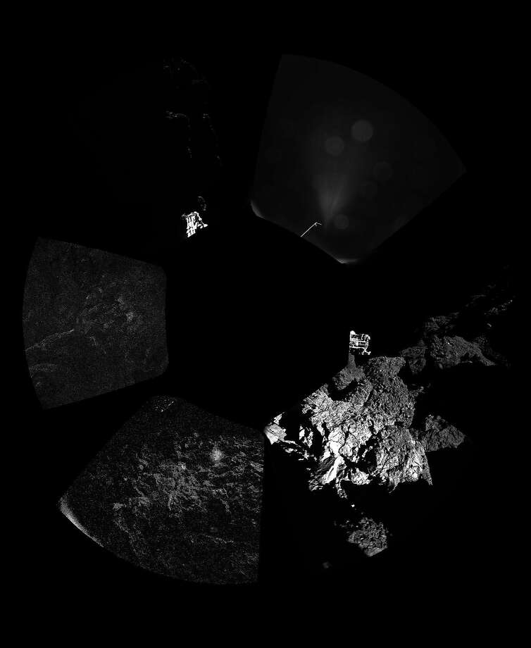 IN SPACE:  (EDITORIAL USE ONLY) This November 13, 2014 handout photo provided by the European Space Agency (ESA) shows the first panoramic 'postcard' from the surface of a comet returned by Rosetta's lander Philae, which landed on the 67P/Churyumov-Gerasimenko comet's surface yesterday. ESA, despite some malfunctions on the Philae craft, successfully landed it on the comet on November 12, 2014 making it the first man-made craft to ever land on a comet. The Philae lander, launched from the Rosetta probe, is a mini laboratory that will gather data on the comet.  (Photo ESA via Getty Images) Photo: Handout, ESA Via Getty Images
