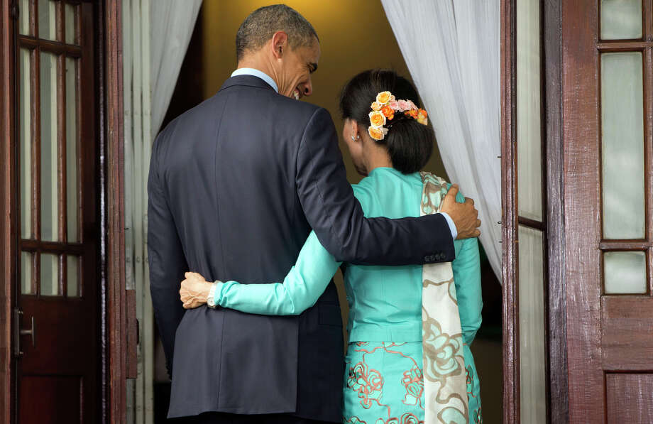 President Obama and Aung San Suu Kyi walk back to her home following a press conference. Photo: Pablo Martinez Monsivais / Associated Press / AP