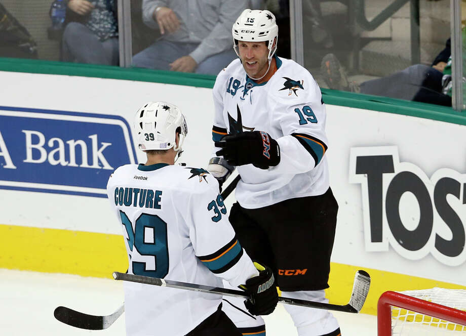 After a rough 2013-14 season, Joe Thornton (19) is off to a solid offensive start, with six goals and 16 points in the Sharks' first 18 games this season. Photo: Tony Gutierrez / Associated Press / AP