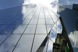 Clouds are reflected on the 27-story 535 Mission Street office tower in San Francisco, Calif. on Friday, Nov. 14, 2014.