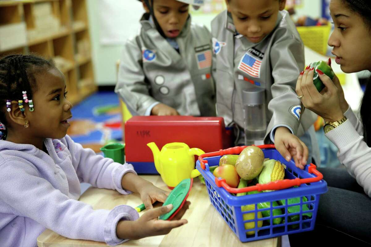 This file photo shows pre-kindergarten students playing with pretend food in a program to educate children about nutrition and health. Nutritious food and exercise are crucial in the fight against childhood obesity.