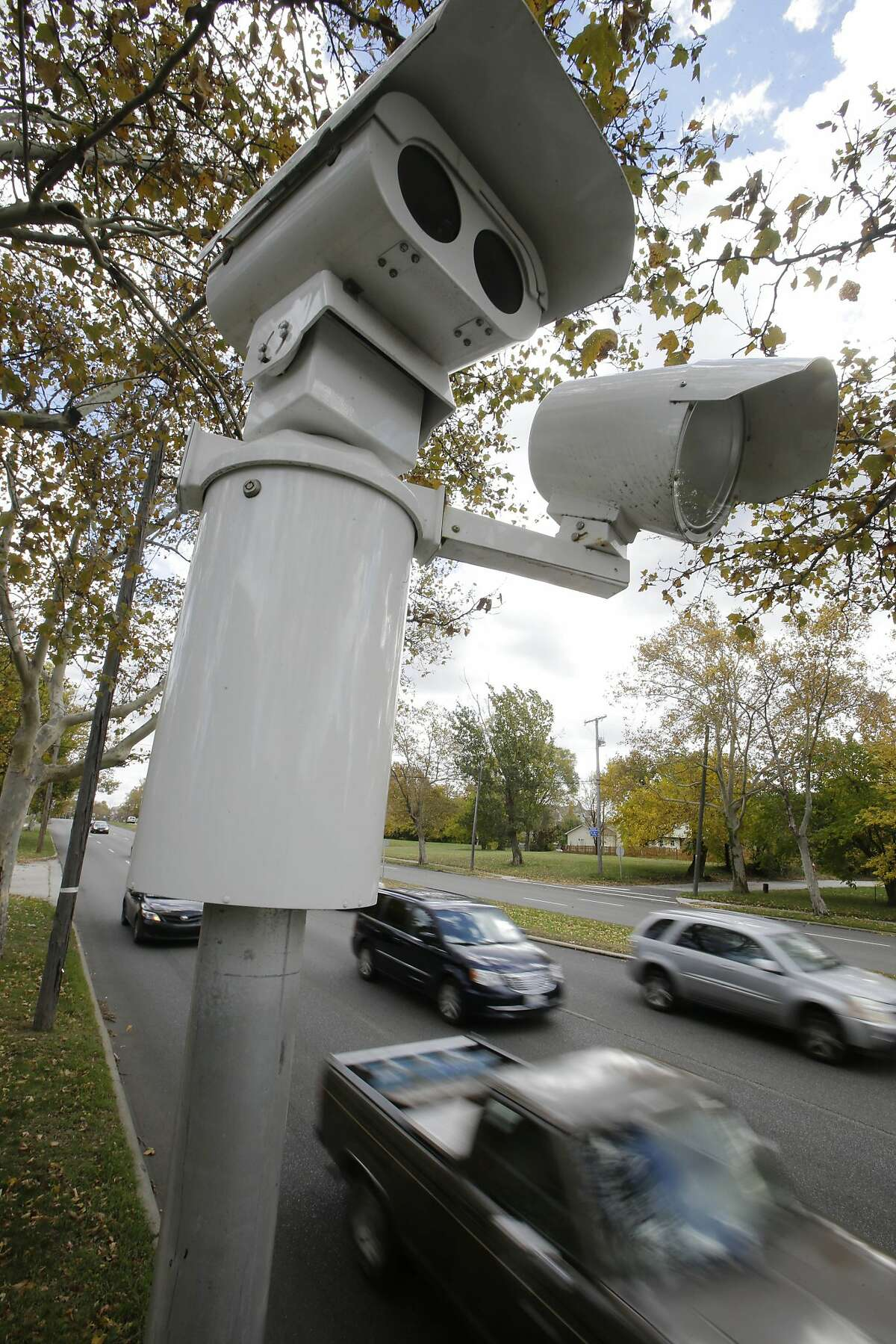 Motorists pass an automated traffic camera on Wednesday, Oct. 29, 2014, in Cleveland.