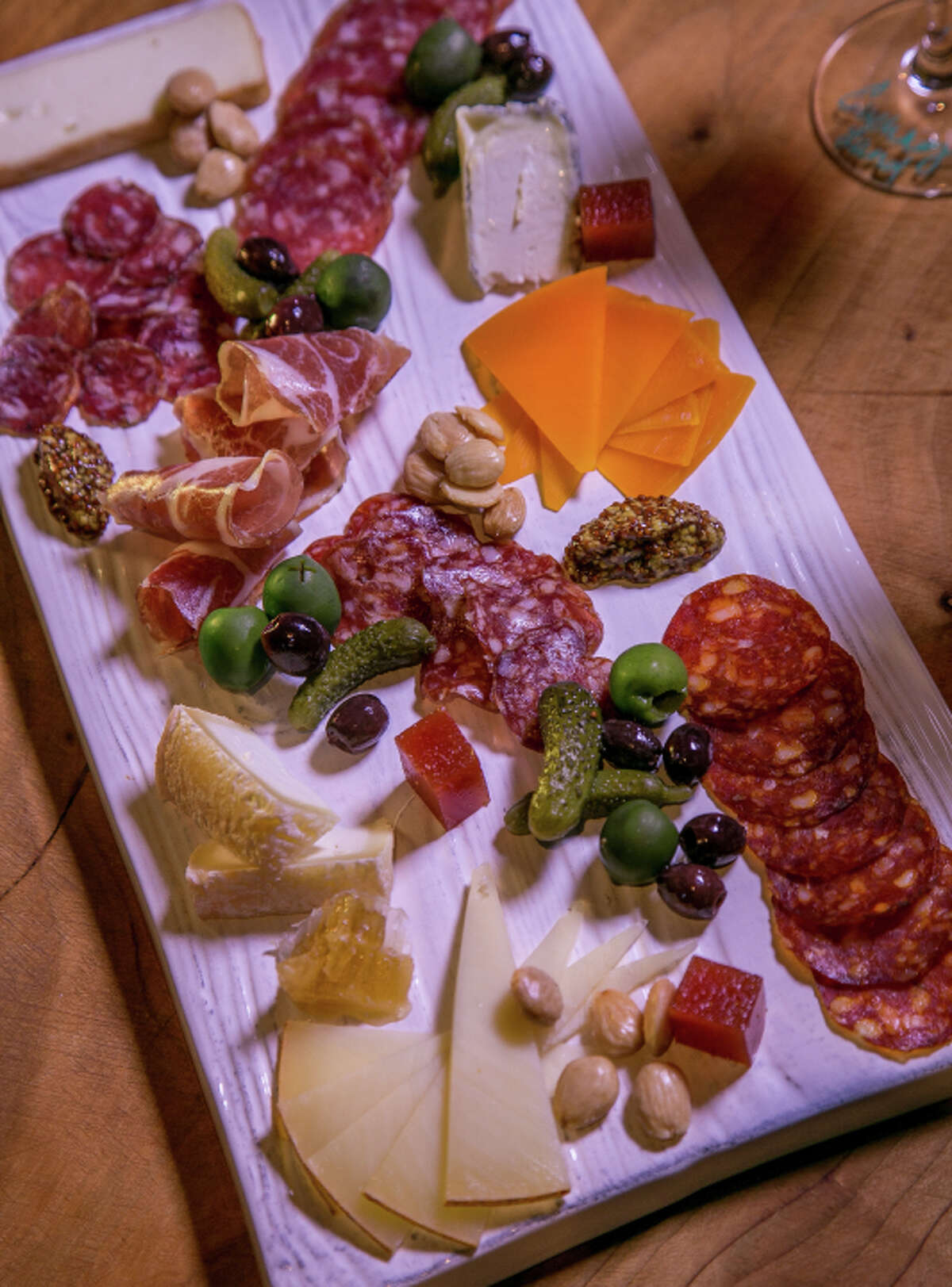 The charcuterie plate at Les Clos comes in a striking presentation, with the meats changing regularly.