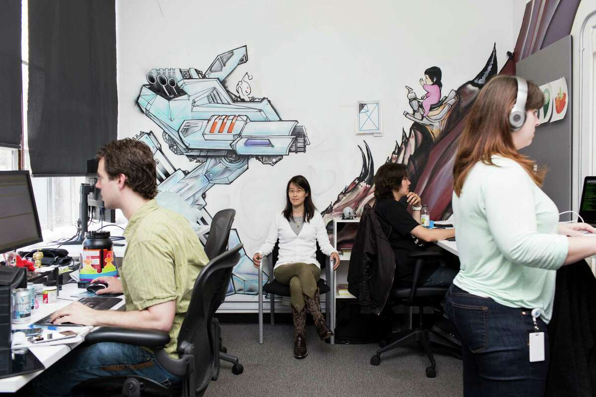 Ellen Pao, center, Reddit's business and partnerships strategist, at the popular website's offices in San Francisco, July 16, 2014. Pao will serve as interim chief executive in the wake of the resignation of Yishan Wong, and one of Reddit's co-founders, Alexis Ohanian, will return to become its full-time executive chair, the company announced on Thursday Nov. 13, 2014.