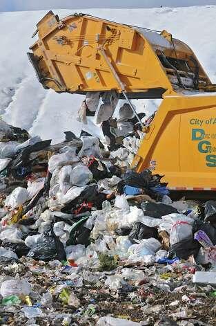 A garbage truck empties its contents at the Rapp Road Landfill  Jan. 20, 2011, in Albany, N.Y. (Lori Van Buren / Times Union) Photo: Lori Van Buren / 00011806A