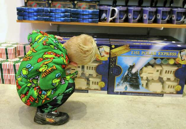 Joseph Robert, 2, of Schoharie, checks out the wooden toy  Polar Express train sets in a gift shop before the official opening of The Polar Express train ride at the Saratoga Train Depot on Friday, Nov. 14, 2014 in Saratoga Springs, N.Y.  (Lori Van Buren / Times Union) Photo: Lori Van Buren / 00029477A
