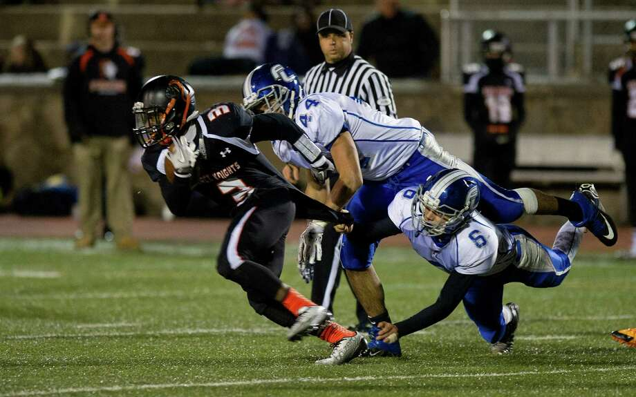 Stamford's Tyree Smith carries the ball during Friday's football game against Fairfield Ludlowe at Stamford High School on November 14, 2014. Photo: Lindsay Perry / Stamford Advocate