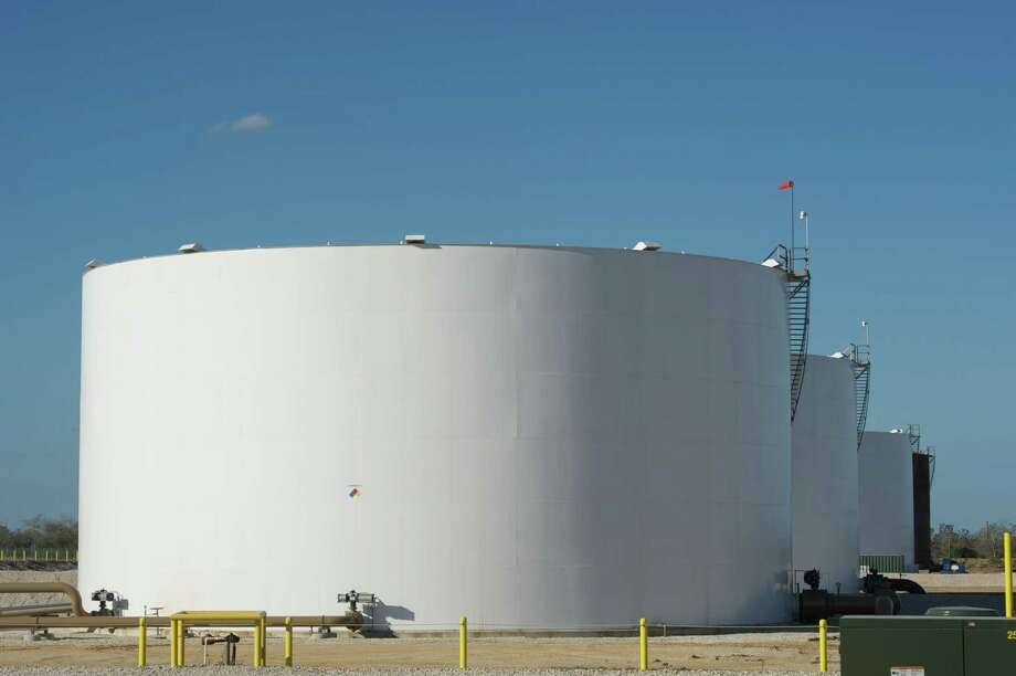 Condensate storage tanks sit at the Black Hawk Central Production Facility. After the $2.8 billion impairment, BHP said it will have about $24 billion in net operating assets in the U.S. Photo: BHP Billiton / BHP Billiton