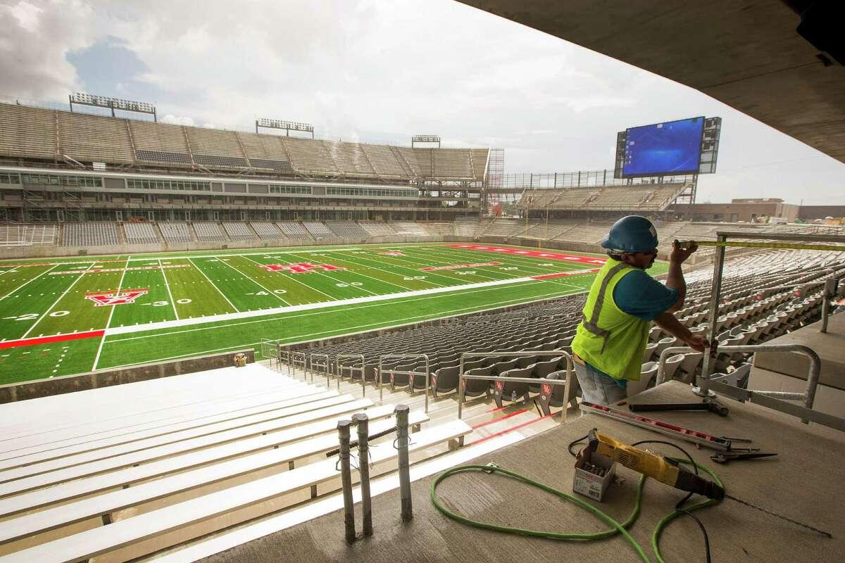 Elvis Hernandez works on installing a guardrail at TDECU Stadium on the University of Houston Campus Tuesday, Aug. 5, 2014, in Houston. TDECU Stadium is scheduled to open on August 29, went UH plays the University of Texas-San Antonio. ( Brett Coomer / Houston Chronicle )