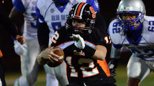 Football action between Shelton and West Haven in Shelton, Conn., on Friday Nov. 14, 2014.