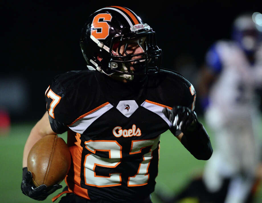 Shelton's Samuel Kirk carries the ball, during football action against West Haven in Shelton, Conn., on Friday Nov. 14, 2014. Photo: Christian Abraham / Connecticut Post