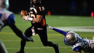 Shelton QB Mark Piccirillo carries the ball, during football action against West Haven in Shelton, Conn., on Friday Nov. 14, 2014.