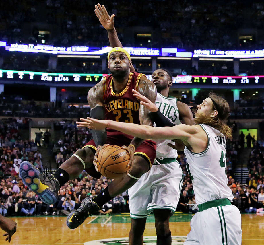 LeBron James, who had 41 points, draws the attention of Kelly Olynyk (right) on a drive in the second quarter. Photo: Charles Krupa / Associated Press / AP