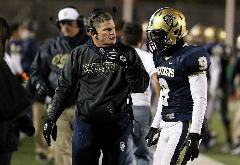 O'Connor football coach David Malesky talks to player Tim Scurry (09) during the game against Southwest at the Class 6A bidistrict game at Gustafson Stadium on Friday, Nov. 14, 2014. Photo: Kin Man Hui, San Antonio Express-News / ©2014 San Antonio Express-News