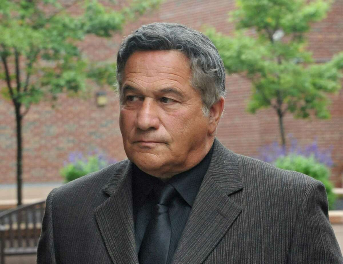 Bruce Tanski, left, leaves the Saratoga County Courthouse with his attorney William Dreyer after he was arraigned on an eight-count indictment that accuses him of offering a false instrument and seven election law violations on Friday, Aug. 22, 2014 in Ballston Spa, N.Y. Tanski, a prominent Halfmoon builder, was arrested by State Police on charges alleging he paid employees and business associates to make political contributions to the campaign account of Melinda Wormuth, a former Halfmoon town supervisor. (Lori Van Buren / Times Union)