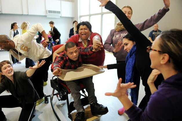 Ray Kirkley, center, and Tess Breedlove interact with dancers during rehearsal for a collaborative dance performance on Thursday, Nov. 13, 2014, at Albany Academy for Girls  in Albany, N.Y. Ellen Sinopoli Dance Co. and dance students from Albany Academy for Girls performed with severely disabled adults from the Center for Disability Services. (Cindy Schultz / Times Union) Photo: Cindy Schultz / 00029467A