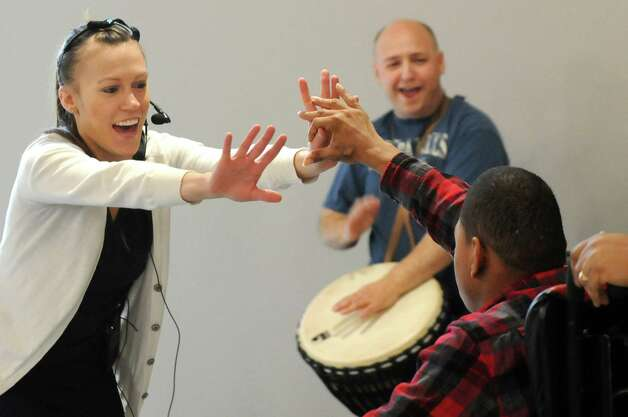 Dancer Marie Klaiber, left, leads Ray Kirkley, left, around the stage as Brian Melick plays a hand drum during rehearsal for a collaborative dance performance on Thursday, Nov. 13, 2014, at Albany Academy for Girls  in Albany, N.Y. Ellen Sinopoli Dance Co. and dance students from Albany Academy for Girls performed with severely disabled adults from the Center for Disability Services. (Cindy Schultz / Times Union) Photo: Cindy Schultz / 00029467A