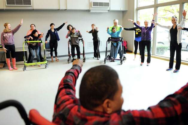 Ray Kirkley, in front, gets a turn at leading a movement exercise during rehearsal for a collaborative dance performance on Thursday, Nov. 13, 2014, at Albany Academy for Girls  in Albany, N.Y. Ellen Sinopoli Dance Co. and dance students from Albany Academy for Girls performed with severely disabled adults from the Center for Disability Services. (Cindy Schultz / Times Union) Photo: Cindy Schultz / 00029467A
