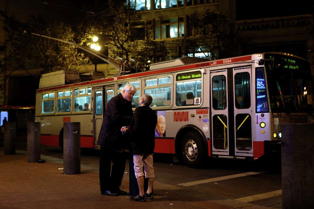 San Francisco Night Ministry's Lyle Beckman talks on Market Street with a woman whom he regularly crosses paths with during his nightly 10pm to 4am shift in San Francisco, Calif., on Monday, November 10, 2014.
