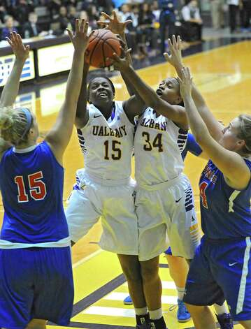 UAlbany's Jessica Fequiere, #15, grabs the ball as she goes up for a rebound with her teammate Cassandra Edwards, #34, during a basketball game against St Francis of Brooklyn at University of Albany on Friday, Nov. 14, 2014 in Albany, N.Y. (Lori Van Buren / Times Union) Photo: Lori Van Buren / 00029432A
