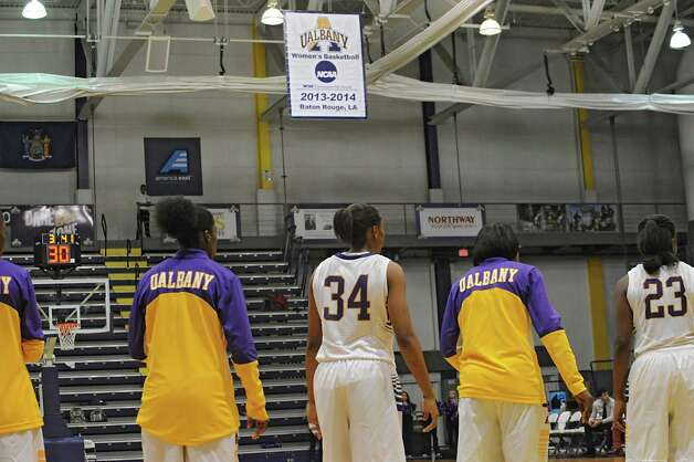 Members of UAlbany women's basketball team watch as a banner is unveiled from last year's NCAA game in Baton Rouge, LA at half time during a basketball game against St Francis of Brooklyn at University of Albany on Friday, Nov. 14, 2014 in Albany, N.Y. (Lori Van Buren / Times Union) Photo: Lori Van Buren / 00029432A