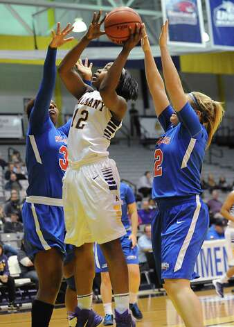 UAlbany's Imani Tate goes up for a shot during a basketball game against St Francis of Brooklyn at University of Albany on Friday, Nov. 14, 2014 in Albany, N.Y. (Lori Van Buren / Times Union) Photo: Lori Van Buren / 00029432A