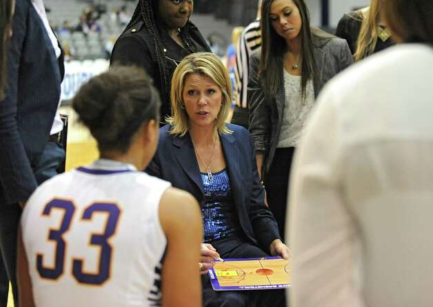 UAlbany head coach Katie Abrahamson-Henderson goes over plays with her team during a time out in a basketball game against St Francis of Brooklyn at University of Albany on Friday, Nov. 14, 2014 in Albany, N.Y. (Lori Van Buren / Times Union) Photo: Lori Van Buren / 00029432A