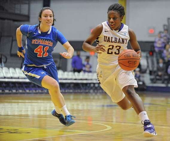 UAlbany's Zakiya Saunders is guarded by St Francis of Brooklyn's Eilidh Simpson as she drives with the ball to the hoop during their opening basketball game at University of Albany on Friday, Nov. 14, 2014 in Albany, N.Y.  (Lori Van Buren / Times Union) Photo: Lori Van Buren / 00029432A
