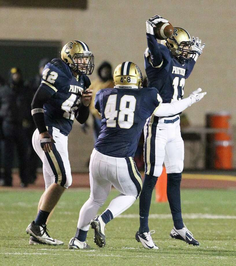 O'Connor's Erik Vaughn (13) celebrates after his first of three interceptions in the first half against Southwest during the Class 6A bidistrict football game at Gustafson Stadium on Friday, Nov. 14, 2014. (Kin Man Hui/San Antonio Express-News) Photo: Kin Man Hui, Staff / San Antonio Express-News / ©2014 San Antonio Express-News