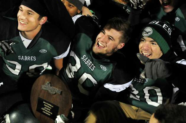 Schalmont's football team celebrates their Class B state quarterfinal win over Peru on Friday, Nov. 14, 2014, at Shenendehowa High in Clifton Park, N.Y. From left are Kyle Strube, Jack Batchler and Cameron Brooks. (Cindy Schultz / Times Union) Photo: Cindy Schultz / 00029471A