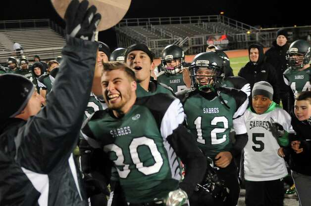 Schalmont's football team celebrates their Class B state quarterfinal win over Peru on Friday, Nov. 14, 2014, at Shenendehowa High in Clifton Park, N.Y. (Cindy Schultz / Times Union) Photo: Cindy Schultz / 00029471A