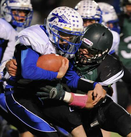 Schalmont's Nick Gallo, right, works to pull down Peru's Luke Carpenter during their Class B state quarterfinal football game on Friday, Nov. 14, 2014, at Shenendehowa High in Clifton Park, N.Y. (Cindy Schultz / Times Union) Photo: Cindy Schultz / 00029471A