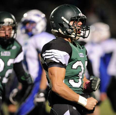 Schalmont's Nick Gallo, right, lets out a roar after a big defensive play during their Class B state quarterfinal football game against Peru on Friday, Nov. 14, 2014, at Shenendehowa High in Clifton Park, N.Y. (Cindy Schultz / Times Union) Photo: Cindy Schultz / 00029471A