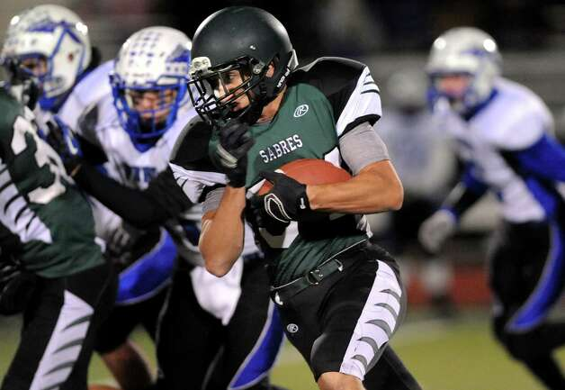 Schalmont's Dalton Cooke, center, gains yards during their Class B state quarterfinal football game against Peru on Friday, Nov. 14, 2014, at Shenendehowa High in Clifton Park, N.Y. (Cindy Schultz / Times Union) Photo: Cindy Schultz / 00029471A
