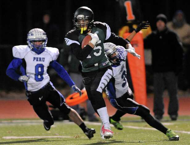 Schalmont's Devin Higgins, center, catches the opening kickoff and runs all the way for a touchdown during their Class B state quarterfinal football game against Peru on Friday, Nov. 14, 2014, at Shenendehowa High in Clifton Park, N.Y. (Cindy Schultz / Times Union) Photo: Cindy Schultz / 00029471A