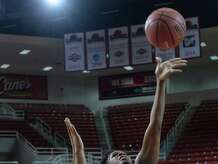 Lamar University's Dominique Edwards gets her shot past a University of Louisiana at Lafayette defender during the Lady Cardinals' season opener at the Montagne Center Friday. The men's team plays their opening game on the road Sunday. Photo taken Friday, November 14, 2014 Kim Brent/The Enterprise