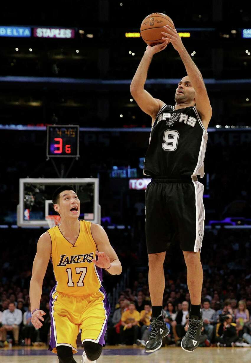 San Antonio Spurs' Tony Parker, right, of France, shoots as Los Angeles Lakers' Jeremy Lin watches during the first half of an NBA basketball game Friday, Nov. 14, 2014, in Los Angeles. (AP Photo/Jae C. Hong)