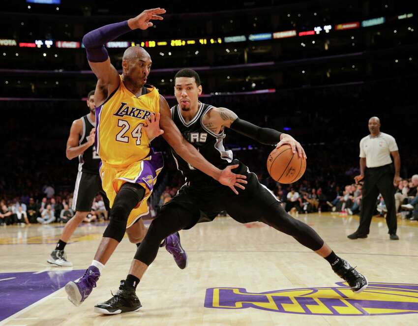 San Antonio Spurs' Danny Green, right, is pressured by Los Angeles Lakers' Kobe Bryant during the first half of an NBA basketball game Friday, Nov. 14, 2014, in Los Angeles. (AP Photo/Jae C. Hong)