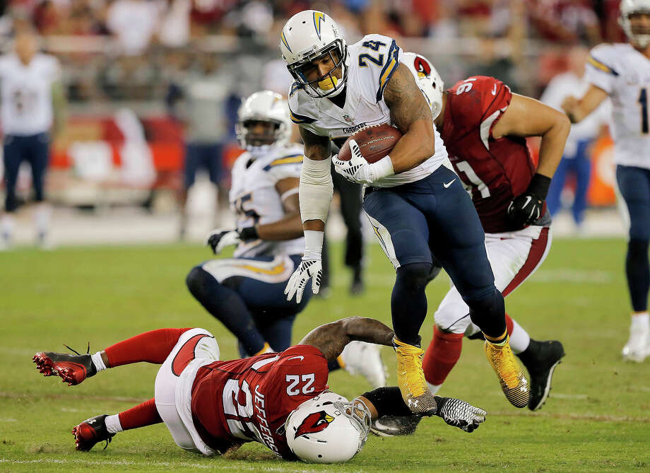 San Diego Chargers running back Ryan Mathews (24) eludes the tackle of Arizona Cardinals free safety Tony Jefferson (22) to score a touchdown during the second half of an NFL football game, Monday, Sept. 8, 2014, in Glendale, Ariz. (AP Photo/Rick Scuteri) Photo: Rick Scuteri / ASSOCIATED PRESS / AP2014