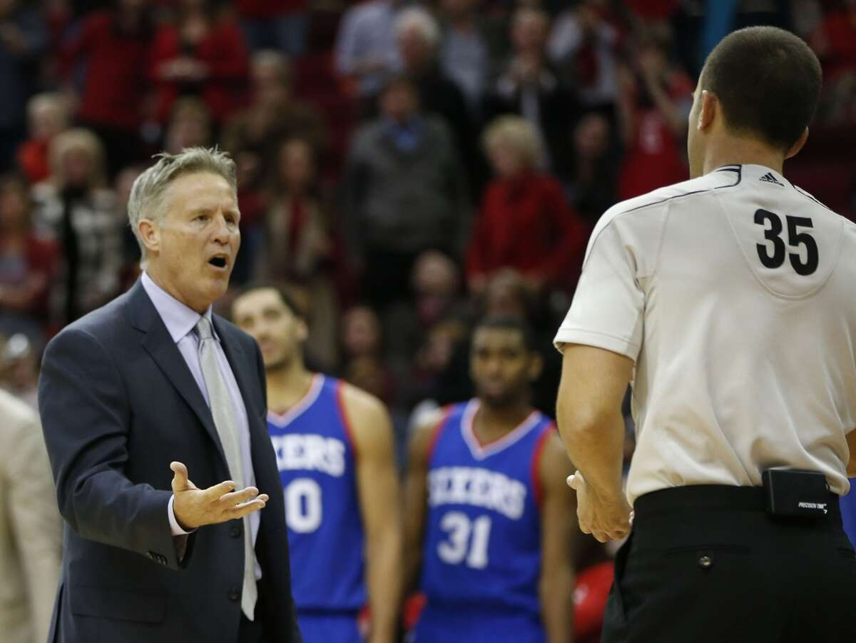 Philadelphia 76ers head coach Brett Brown argues with referee Kane Fitzgerald and gets a technical in the final minute during the second half of an NBA basketball game at Toyota Center, Friday, Nov. 14, 2014, in Houston. ( Karen Warren / Houston Chronicle )