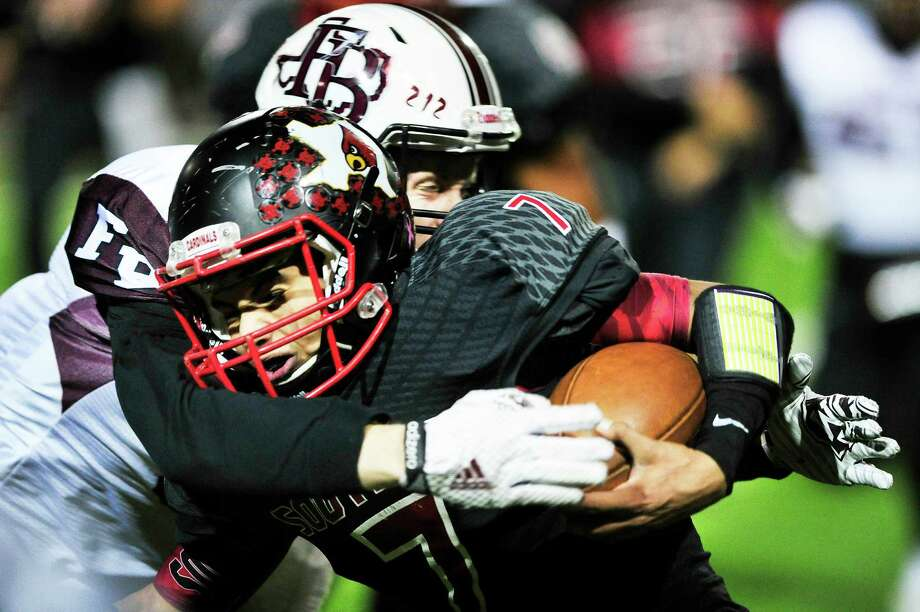 Flour Bluff's Tyler Snell tackles Southside's quarterback Brandon Herrera during the Division 5A high school football game between Southside and Flower Bluff from Corpus Christi on Friday, November 14, 2014. Photo: Matthew Busch, Freelancer / © San Antonio Express-News