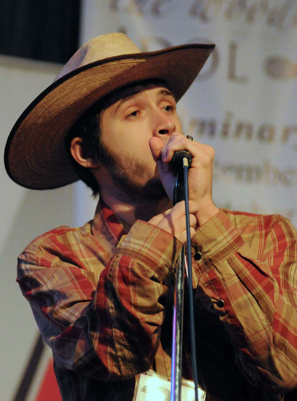 Zachary Jones sings during The Woodlands Idol Finals at Papa's Ice House, 314 Pruitt Road in Spring. The ten finalists performed two songs during the finals. Photograph by David Hopper