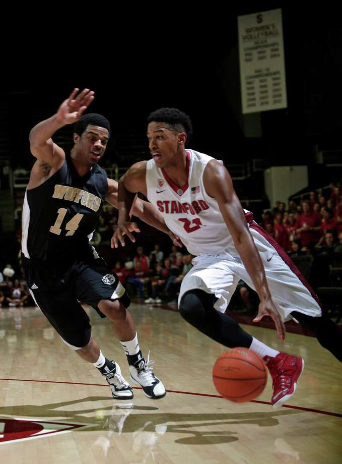 Stanford's Anthony Brown, right, drives around Wofford's Spencer Collins (14) during the first half of an NCAA college basketball game Friday, Nov. 14, 2014, in Stanford, Calif. (AP Photo/Marcio Jose Sanchez) Photo: Marcio Jose Sanchez / Associated Press / AP